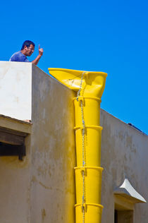 Attention! ... a yellow boot is coming up the wall ... by Paul Artner
