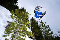 Snowboarder jumping by Ross Woodhall