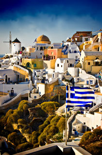 Oia and the Greek flag. by meirion matthias