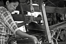 Burmese woman working with a handloom weaving. by RicardMN Photography