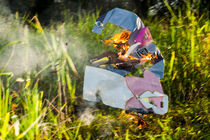 Chinese funeral paper cloths on fire by Chris Christidis