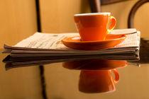 Espresso with newspaper von aremak
