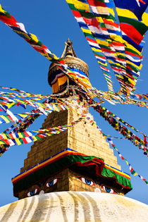 'Prayer flags in the wind at the Boudhanath Stupa.' by Tom Hanslien