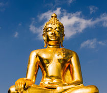 Big golden Buddha statue. by Tom Hanslien