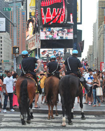 NYPDs at Time Square by John Powell