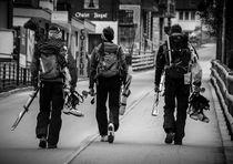 Ski tourers after a tough day on the mountains by Elias Lefas