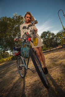 girl on with an old bicycle  by nedyalko petkov