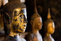 Buddha statues, Wat Xieng Thong. by Tom Hanslien
