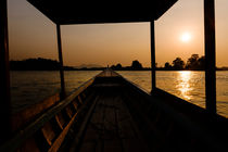 Sunset in a riverboat. by Tom Hanslien