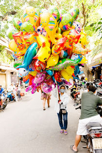 A balloon saleswoman at Hoi An Market. by Tom Hanslien