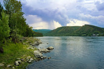 Summer storm in the mountains on the banks of the river von larisa-koshkina