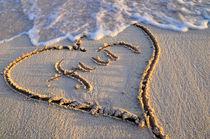 Fun sand writing on a beach by aelita