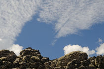 Solidified lava with lichens and clouds by Víctor Suárez