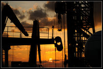 Sunset viewed from an oil rig w border by Bradford Martin