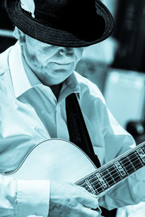 Man in hat playing Guitar by Peter Noyce