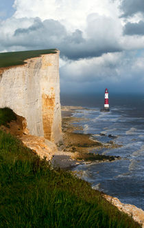 White cliffs and red-white striped lightouse in the sea by Jarek Blaminsky