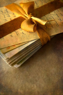 Old letters and a golden ribbon by Jarek Blaminsky
