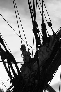 Young woman climbing in the rigging of a tall ship by Intensivelight Panorama-Edition