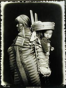 Navaho woman carrying a papoose on her back, c.1914 (b/w photo)  by Bridgeman Art