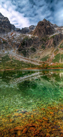 Reflection of mountain lake by Tomas Gregor