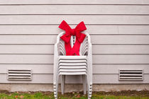 Lawn chair with Red Bow by Jim Corwin