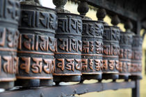 Spinning Buddhist prayer wheels  by studio-octavio