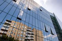 modern skyscraper with glass wall by Arletta Cwalina