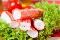Pile of crab sticks surimi  by Arletta Cwalina