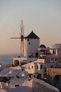 Wind mill during sunset in Thira by gunter70