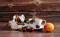 Coffee, cherry, flower and butterfly on a wooden background by larisa-koshkina