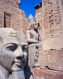the gateway to Luxor temple Egypt with colossi of Ramses II by Sean Burke