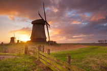Traditional Dutch windmills at sunrise in The Netherlands by Sara Winter