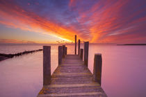Seaside jetty at sunrise on Texel island, The Netherlands by Sara Winter
