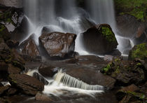 Wet stones and a waterfall by Leighton Collins