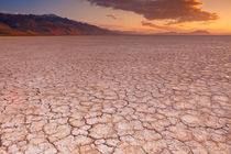 Cracked earth in remote Alvord Desert, Oregon, USA at sunrise by Sara Winter