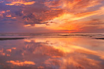 Sunset reflections on the beach, Texel island, The Netherlands by Sara Winter