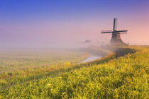 Traditional Dutch windmill at sunrise on a foggy morning by Sara Winter