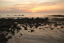 Beach with rocks at sunset Thailand by Perry  van Munster
