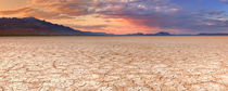 Cracked earth in remote Alvord Desert, Oregon, USA at sunset by Sara Winter
