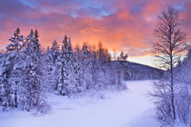 Sunrise over a river in winter near Levi, Finnish Lapland by Sara Winter