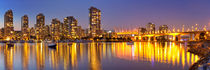 Vancouver, British Columbia, Canada skyline across the water at night by Sara Winter
