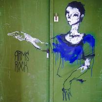 Woman in Blue Painting Graffity on green Door by Ralf Ketterlinus