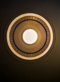 Round staircase in brown tones by Jarek Blaminsky