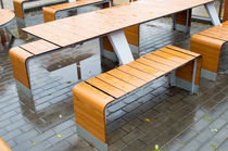 Wet outdoor cafe tables on the street after a rain von Vladislav Romensky