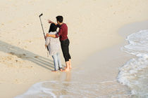 Loving-couple-taking-self-portrait-on-beach