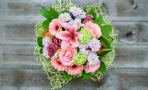 Bouquet of roses, chrysanthemums, gerberas and pink pepper by Marina Dvinskykh
