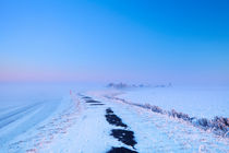 Lake and dike at sunrise in winter in The Netherlands by Sara Winter