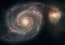 The whirlpool galaxy (M51) and companion galaxy. by Stocktrek Images