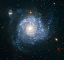 Spiral galaxy NGC 1309. by Stocktrek Images