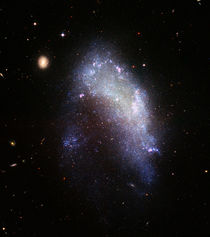 Irregular galaxy NGC 1427A. by Stocktrek Images